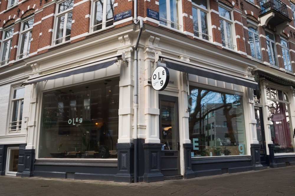 Table Sage Plate's Best of Amsterdam Restaurants- sustainable restaurant Oleg Pelmeni Bar's stone and brick exterior in city center